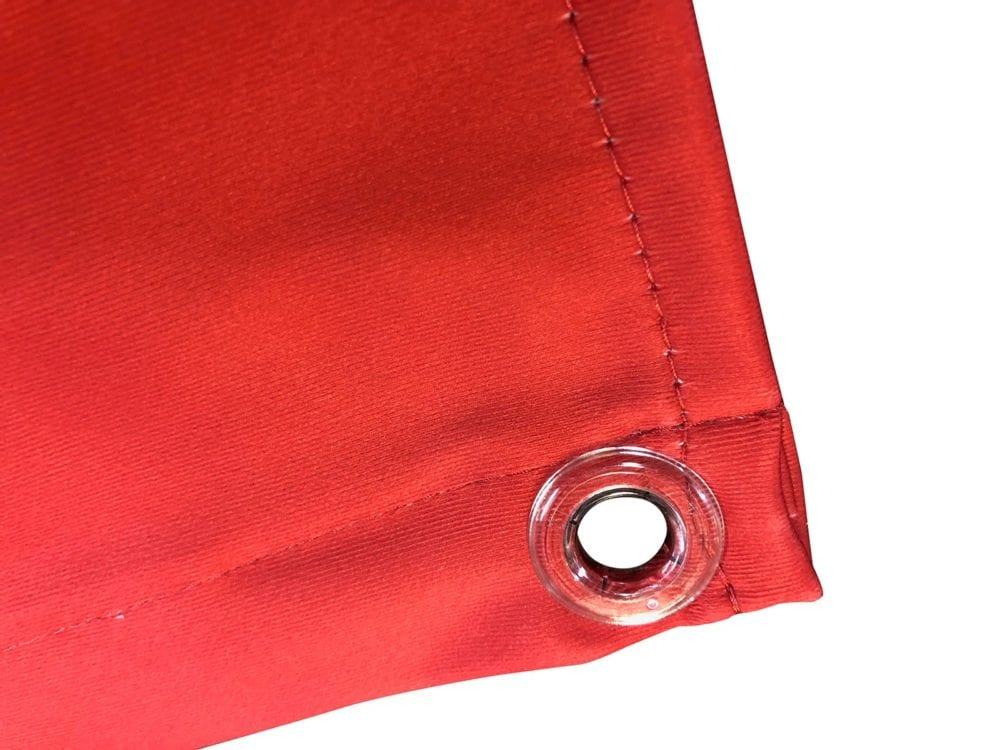 Eyelet on textile backlight material